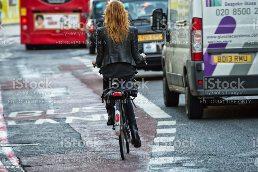 London fedmale bicyclist in traffic stock photo