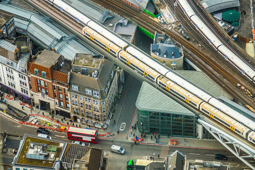 Trains and traffic in the city centre of London, England. Aerial view