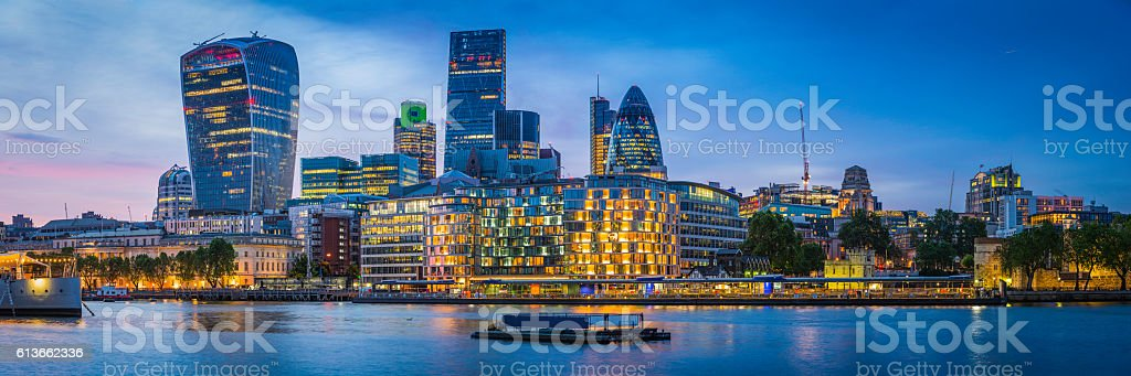 London futuristic skyscrapers glittering at sunset overlooking River Thames UK stock photo