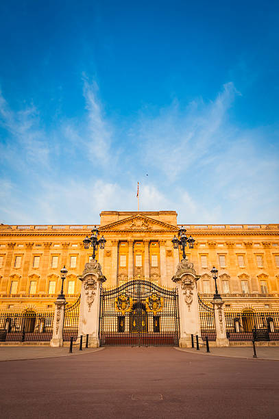 London golden dawn light on Buckingham Palace The Mall UK stock photo