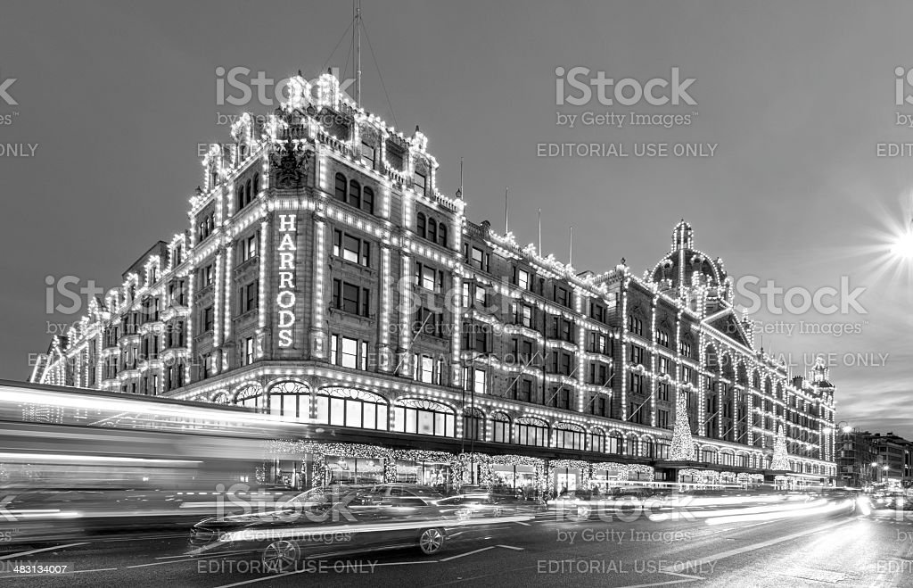 London, Harrods department stores at night in black & white stock photo