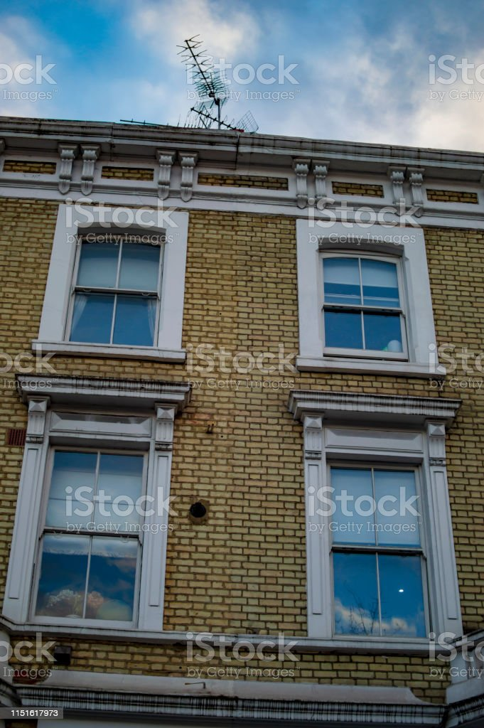 London home windows of large size and blue sky