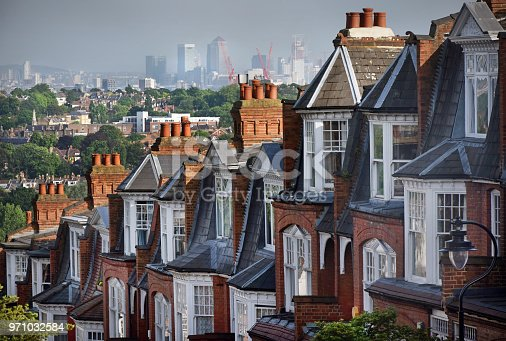 The view over Victorian terraced house at Muswell Hill in North London looking towards the East and skyscrapers of Canary Wharf financial district