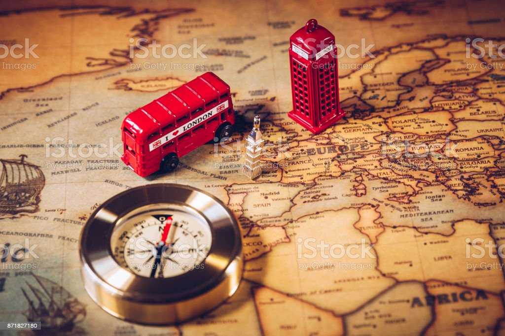 London map with Big Ben, double decker bus in miniature and compass, travel concept. England, UK. stock photo