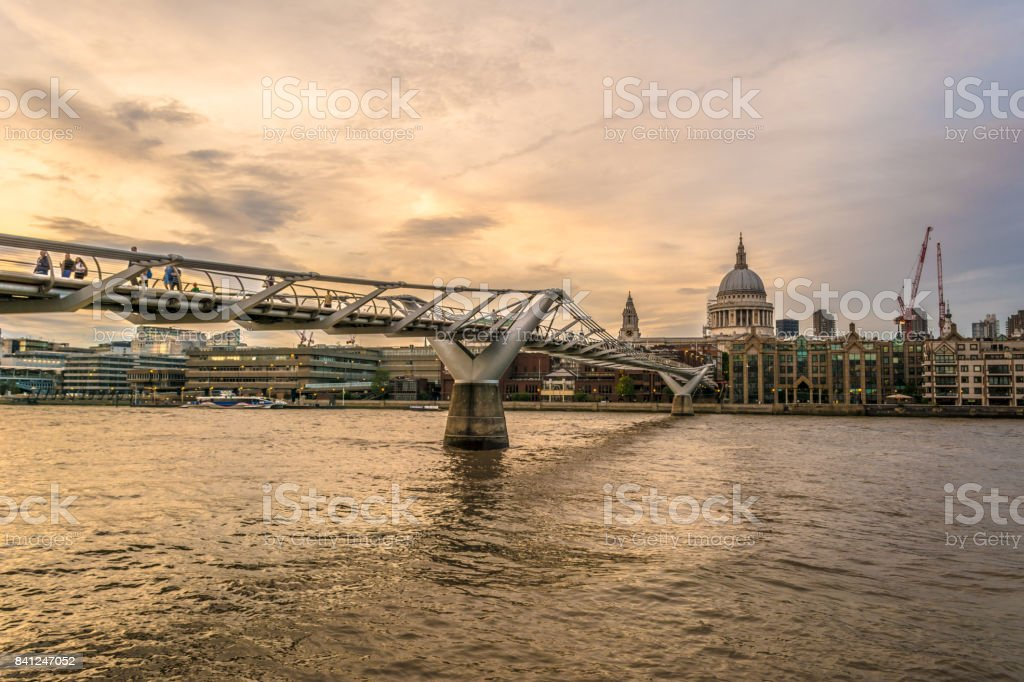 London Millennium Footbridge on the River Thames and St. Pauls Cathedral stock photo