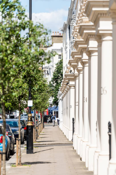 London neighborhood district of Pimlico with vertical view of housing buildings and numbers on columns in old vintage historic traditional style flats stock photo