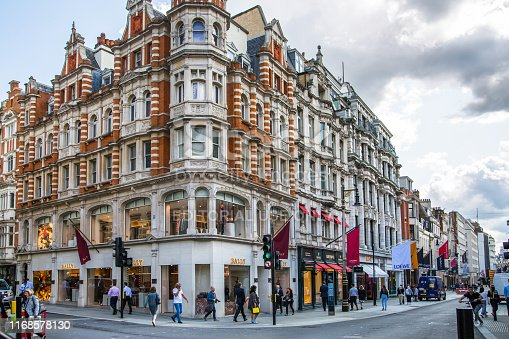 London, UK - August 13, 2019: Old Bond street view with flags of famous fashion houses. Bond Street is a major shopping street in the West End of London for luxury designer brands