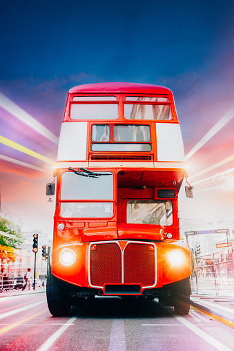London Old Red Bus in motion with light trails