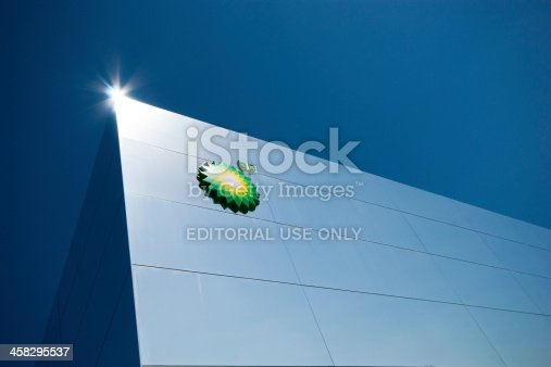 London, England - September 7, 2012: London Olympics BP venue. This is a view of the corner against a deep blue sky, it shows the clean mirrored lines and the styling of this unique building together with teh BP logo and a lens flare on the very corner of the building.
