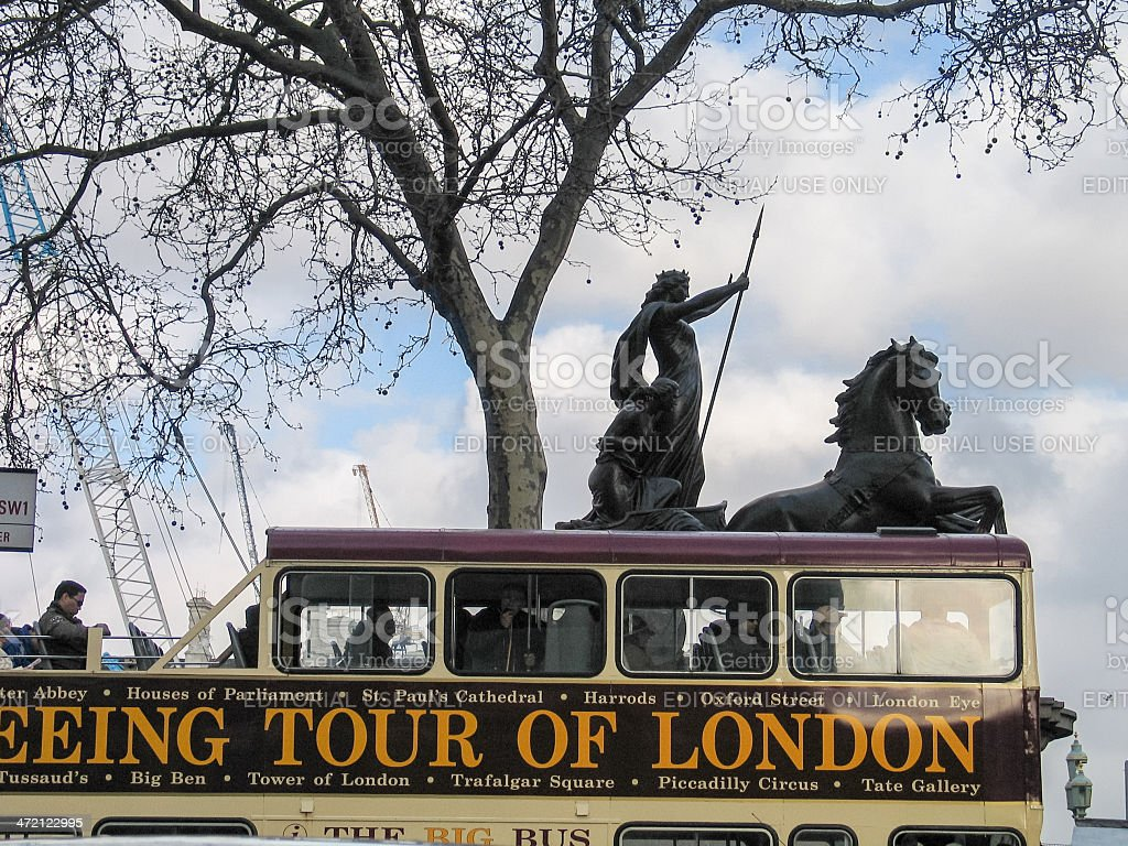 London Open-top Sightseeing Bus Tour moving near Boadicea statue chariot stock photo