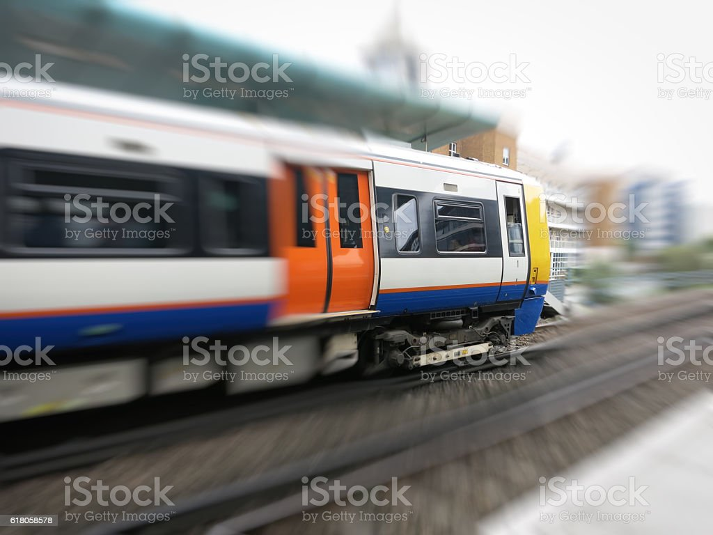 London overground train approaching station stock photo
