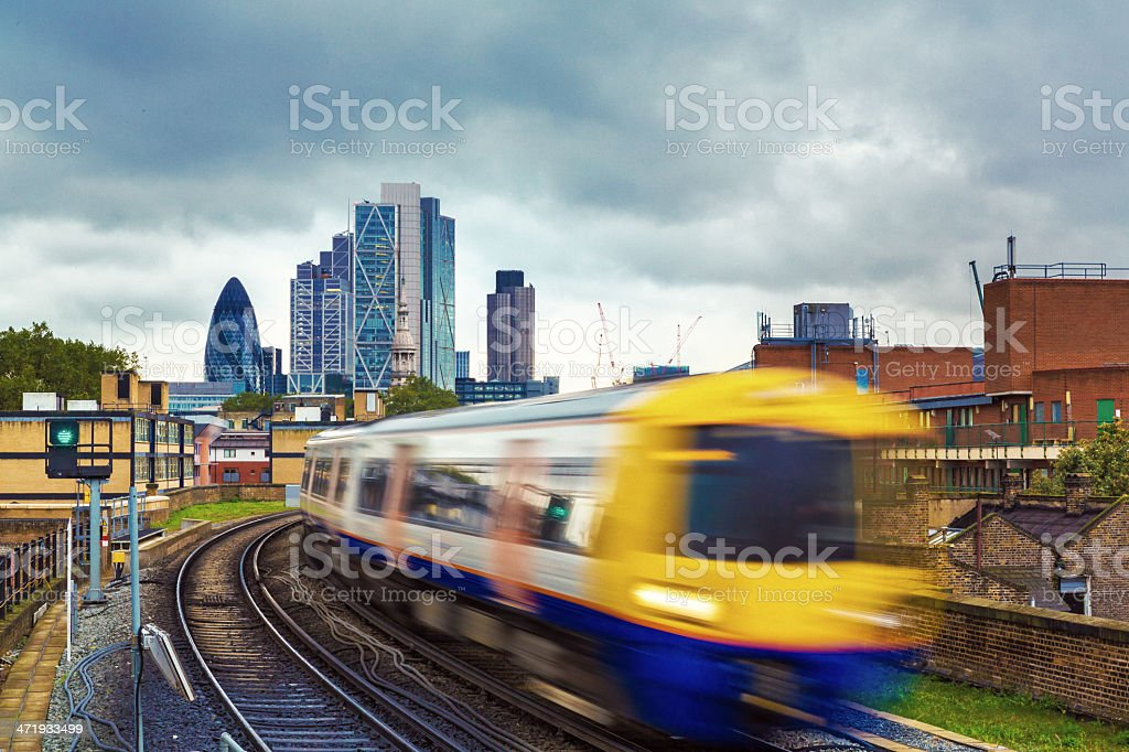 London Overground with skyscrapers in the background stock photo