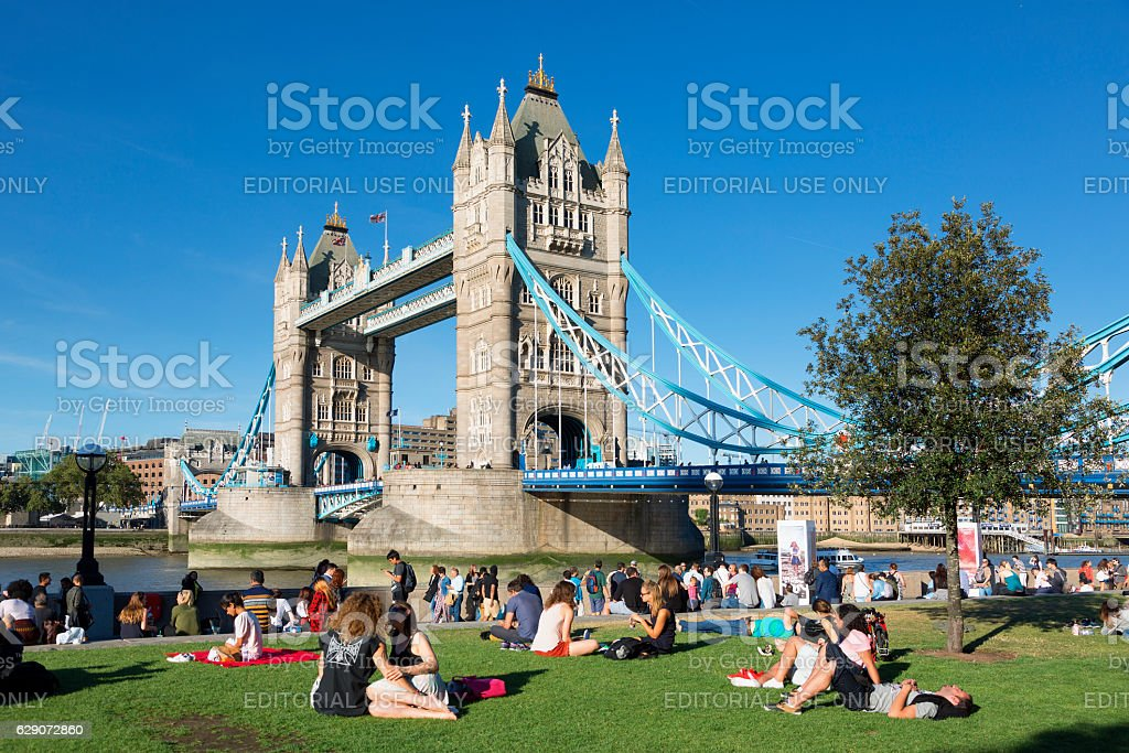 London, people relaxing along the Thames river stock photo