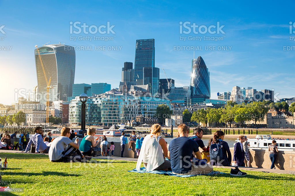 London, People resting along the Thames river stock photo