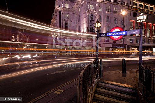 London, UK - Mar 21, 2019: Long Exposure of Red Busses on Regent street in Piccadilly Circus early in the evening.