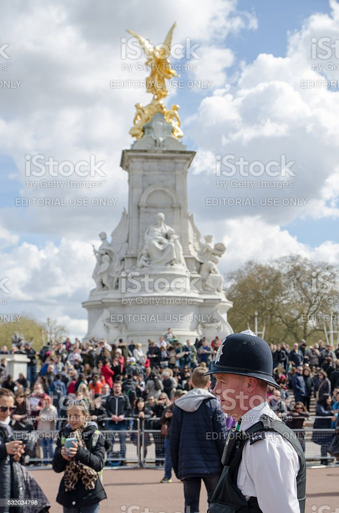 London Policeman in front of crowd stock photo