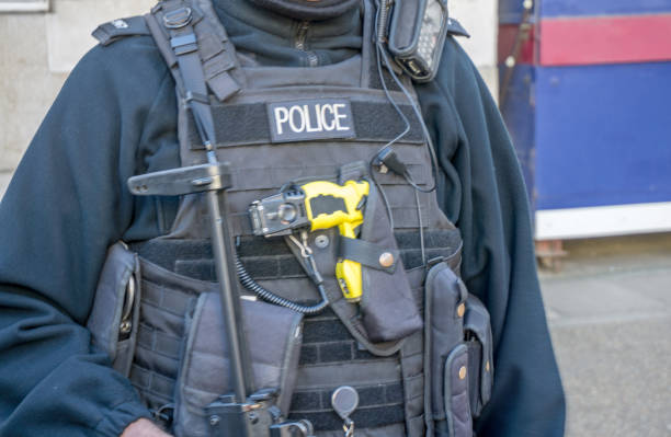 London policeman uniform and equipment London policeman uniform and equipment. Includes taser gun, radios and fully automatic weapon counter terrorism stock pictures, royalty-free photos & images