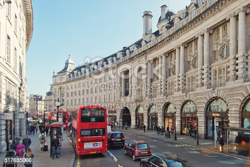 London, UK - March 14, 2016: People walking and shopping on the sidewalks of the major shopping street of Regent Street in London.