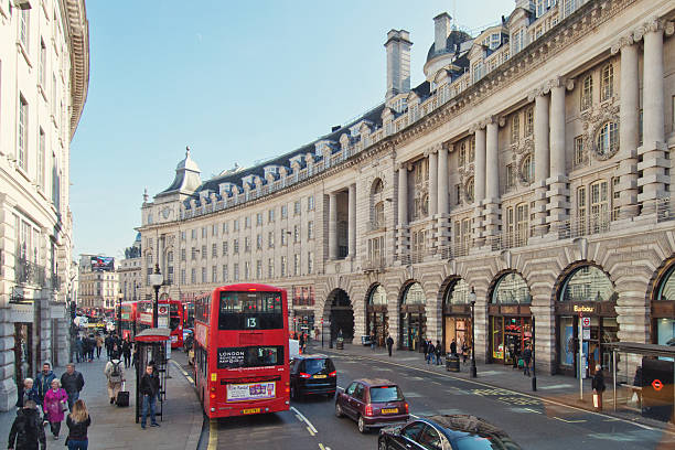 London Regent Street London, UK - March 14, 2016: People walking and shopping on the sidewalks of the major shopping street of Regent Street in London. mayfair stock pictures, royalty-free photos & images