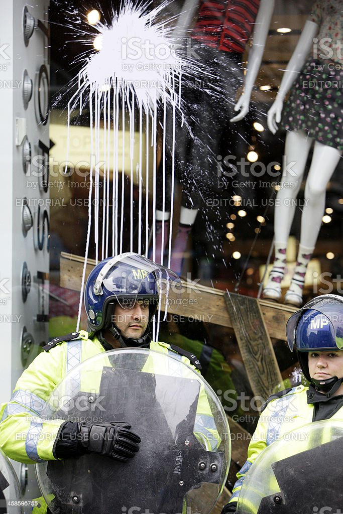 London riot police guarding Top Shop, Oxford Circus. stock photo