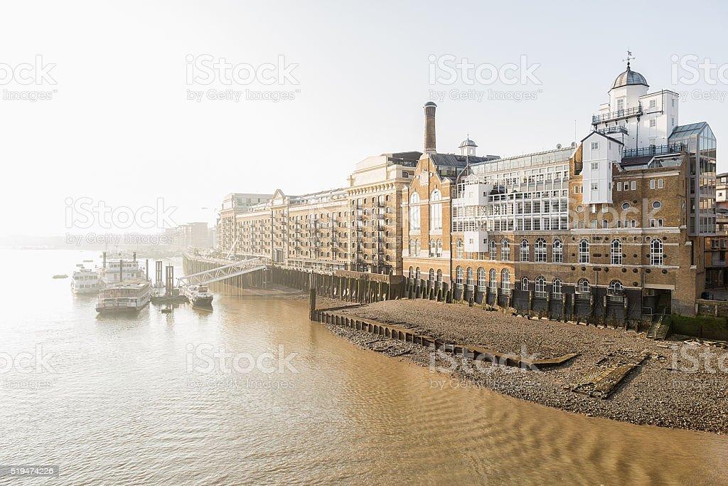 London, river Thames in morning mist. stock photo