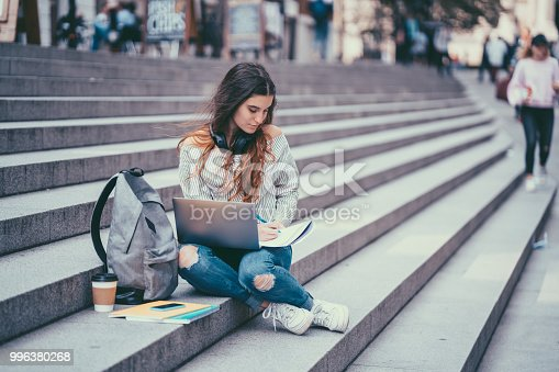 Student studying outside in London