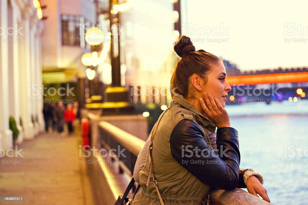 London sightseeing Side view of pensive young woman looking at Thames River. 20-24 Years Stock Photo
