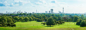London Skyline and Primrose hill park panorama on a sunny September day.