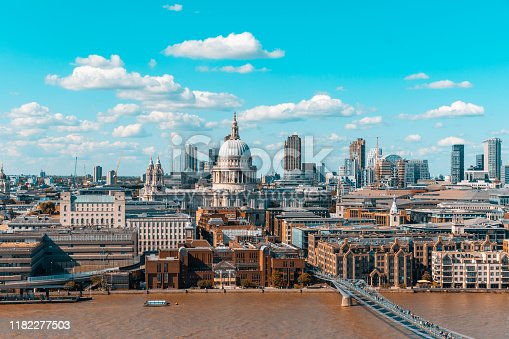 London skyline and St Paul Cathedral aerial view - Panoramic image of London with Thames river on foreground, and the city on background - Travel and architecture concepts