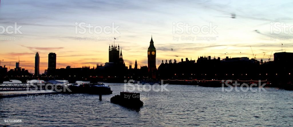 London skyline at night looking along the River Thames stock photo