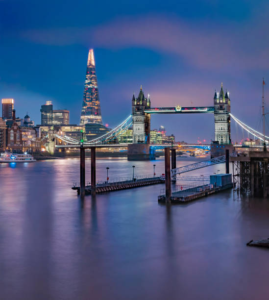 London skyline at night with Tower Bridge and the Shard stock photo