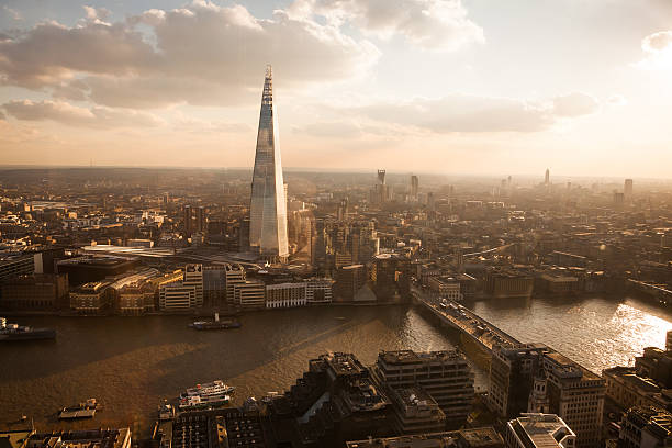 London skyline in front of The Shard at sunset. Vintage. stock photo