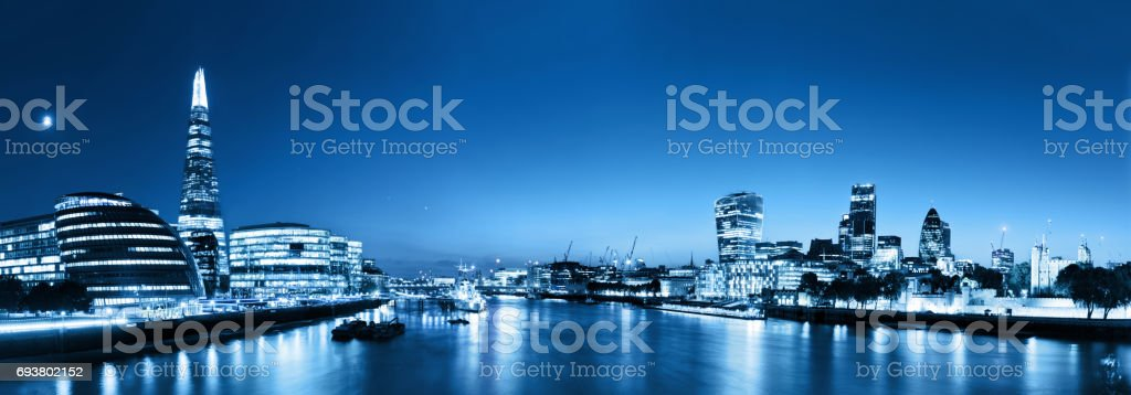 London skyline panorama at night, England the UK. River Thames, the Shard, City Hall. stock photo
