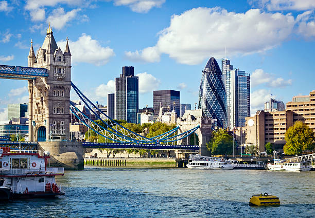 London skyline seen from the River Thames Financial District of London and the Tower Bridge tower bridge stock pictures, royalty-free photos & images