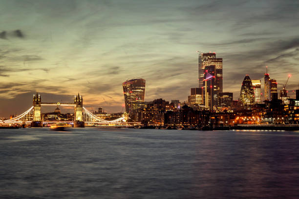 London skyline Tower Bridge and City of London at night London skyline Tower Bridge and City of London at night central london stock pictures, royalty-free photos & images