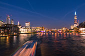 London Skyline with The Chard, London Bridges and Riverboats Crossing the River Thames at Night