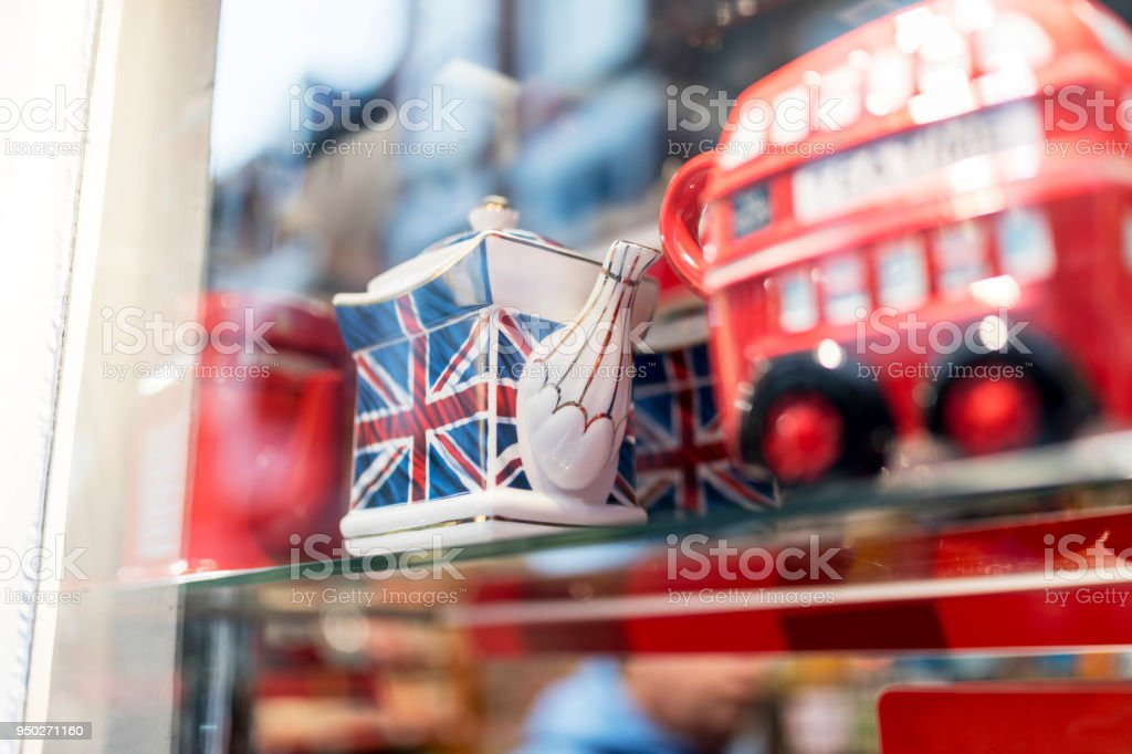 A London souvenir shop displaying British souvenirs including a classic British Union Jack tea pot and a London bus celebrating a royal wedding in the UK stock photo