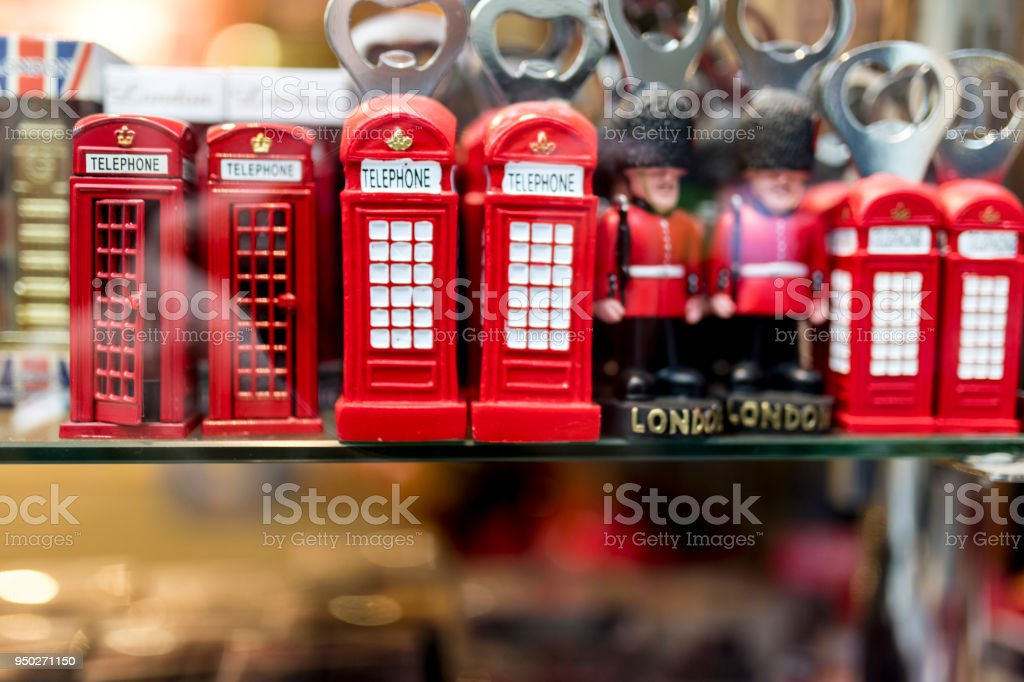 A London souvenir shop displaying British souvenirs including classic British red telephone boxes and beefeater and London Tower Guards bottle openers in the UK stock photo