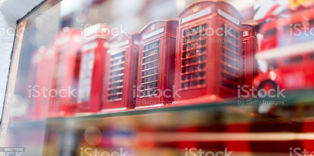 A London souvenir shop displaying British souvenirs including classic British red telephone boxes in the UK stock photo