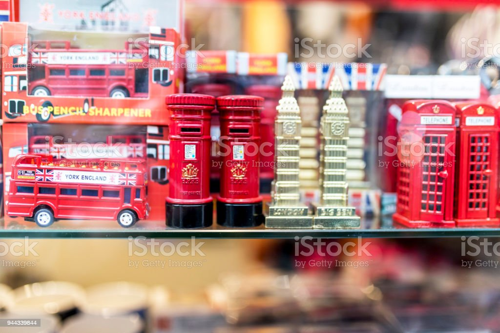 A London souvenir shop displaying British souvenirs including London buses, British red post boxes, Big Ben ornaments and red British telephone boxes on a shelf in the UK stock photo