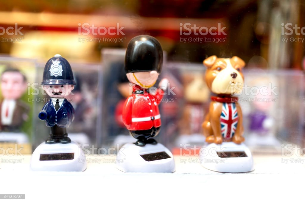 A London souvenir shop displaying cartoon British souvenirs including a British bobby or policeman, a Queens guard and a British bulldog wearing a Union Jack coat in the UK stock photo