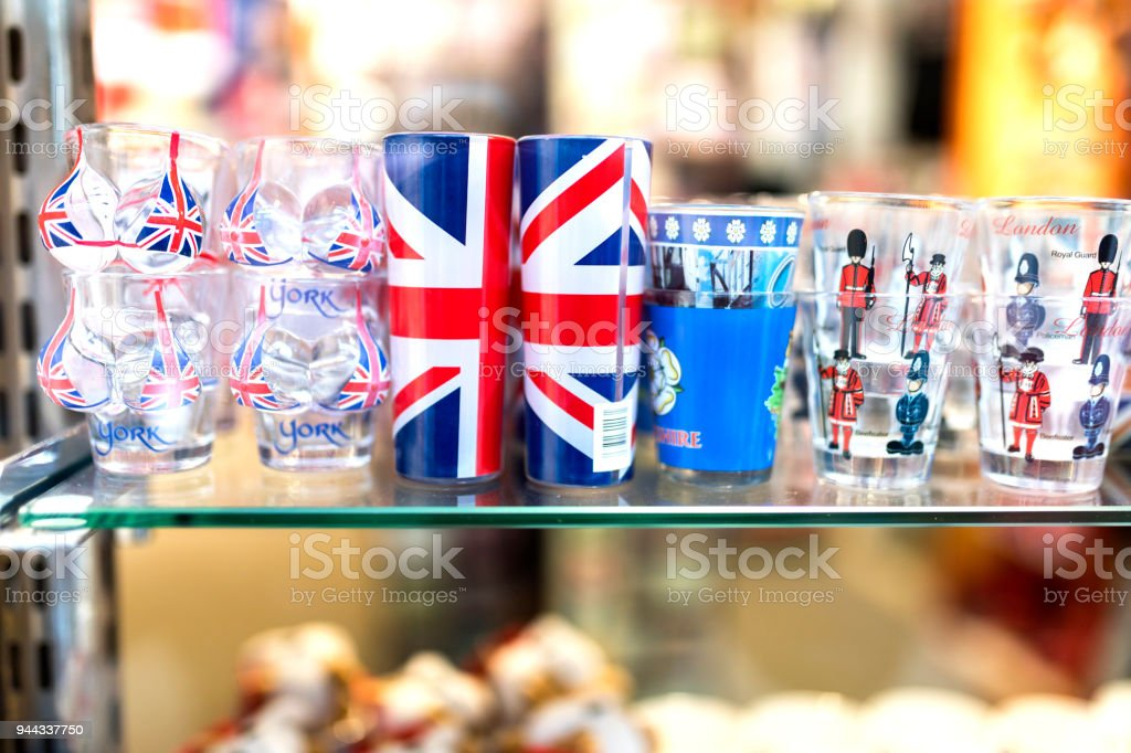 A London souvenir shop displaying English shot glasses with the union jack, keep calm and carry on and beefeater and London Tower Guards printed on them in the UK stock photo