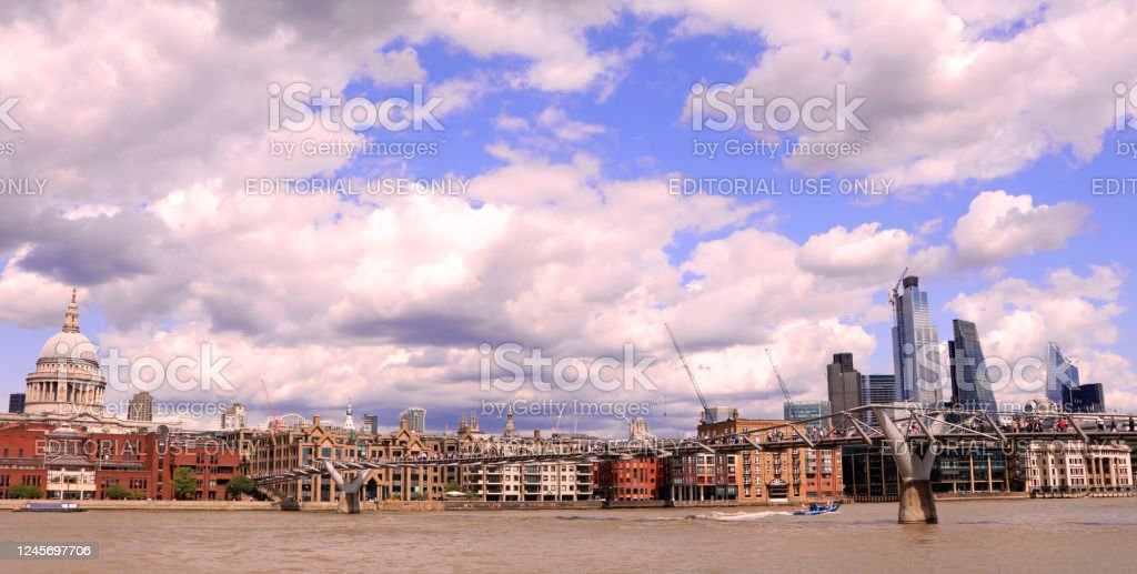 London St Paul's Cathedral London St Paul's Cathedral and Millennium Bridge on Thames, United Kingdom. Architectural Dome Stock Photo