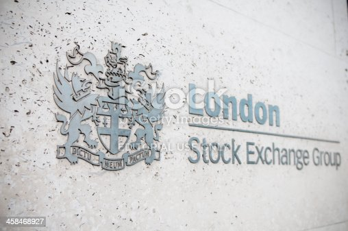 London, United Kingdom - April 24, 2011: London Stock Exchange Group logo, side view, selective focus on the coat of arms. Located in the City of London, at Paternoster Square, the London Stock Exchange was founded in 1801. It is the fourth-largest stock exchange worldwide.