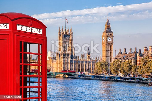 istock London symbols with BIG BEN, DOUBLE DECKER BUSES and Red Phone Booth in England, UK 1295228853