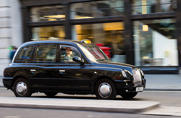 London Taxi at Speed stock photo