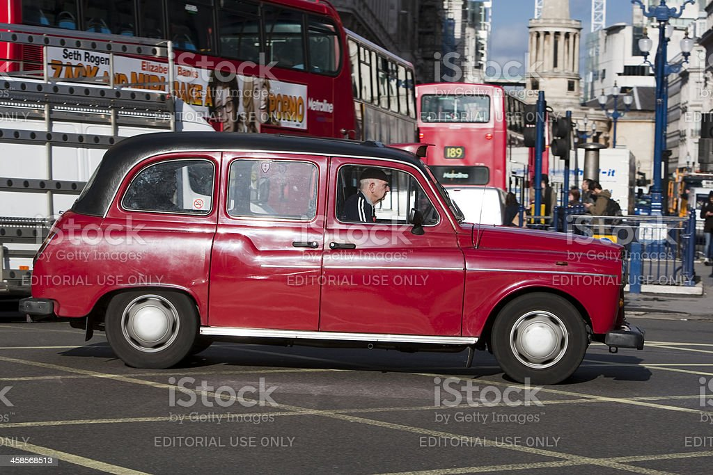 London taxi cab crossing Oxford Circus, Regent Street junction royalty-free stock photo