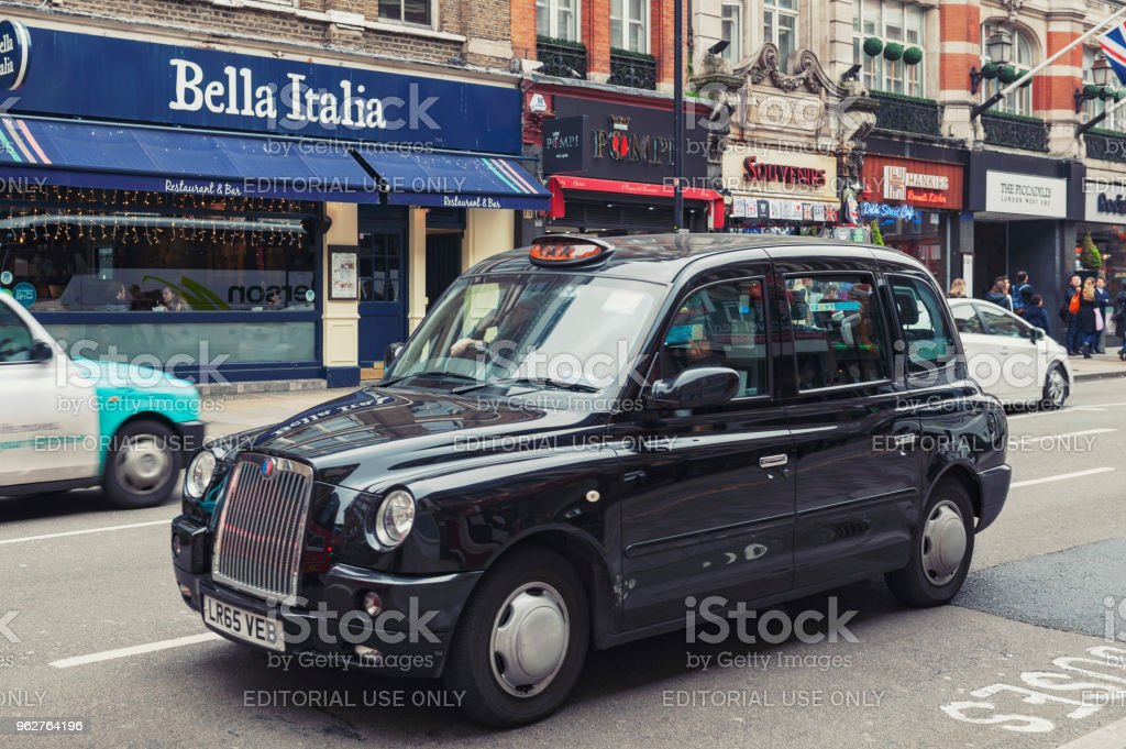 London taxi cab driven on Shaftesbury Avenue, a major street in the West End of London near Piccadilly Circus, city of Westminster stock photo