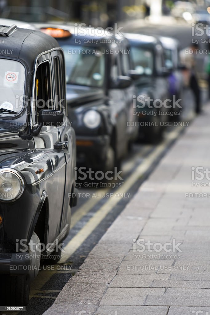 London taxi cabs line up in Canary Wharf royalty-free stock photo