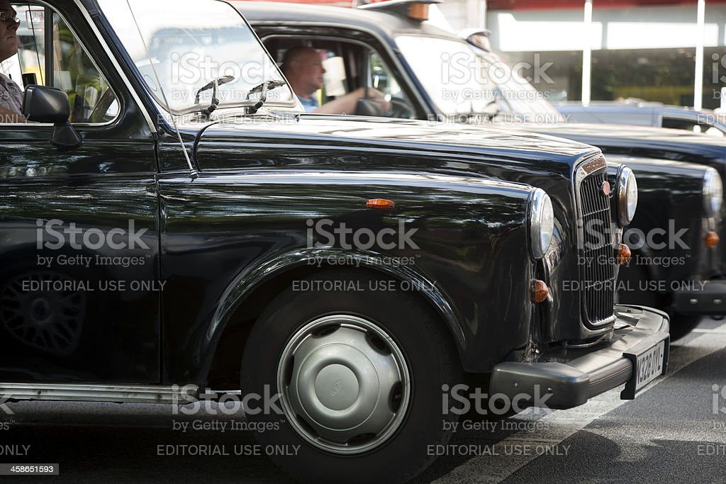 London Taxi Cabs Waiting at Traffic Lights royalty-free stock photo